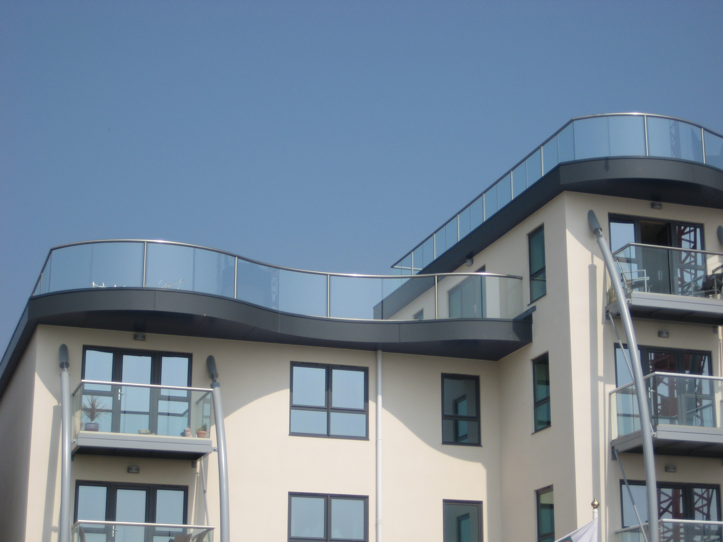 Custom glass balustrade glass banisters glass balustrades for Glass balcony
