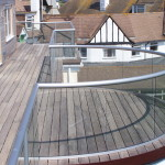 curved and straight glass balcony