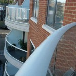curved handrail and curved glass balcony streatham