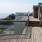glass balcony by the sea